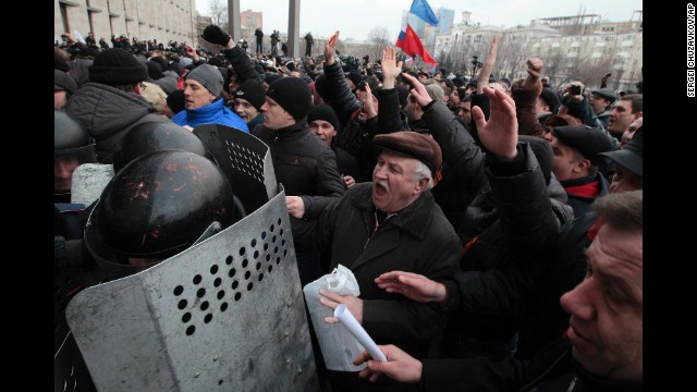 Demonstrators break a police barrier as they storm a regional administrative building in Donetsk on March 5.