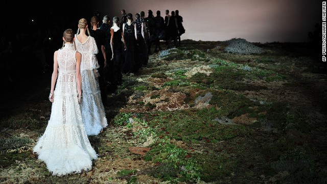 MARCH 5 - PARIS, FRANCE: Models wear creations for the Alexander McQueen ready-to-wear fall/winter 2014-2015 fashion collection on March 4. <a href='http://www.cnn.com/2014/03/04/world/europe/blood-sweat-and-silk-on-the-long-road-to-paris-fashion-week/'>Tradition, quality materials, creativity and global exposure</a> make Paris the ultimate and most desired platform for young and established designers alike.