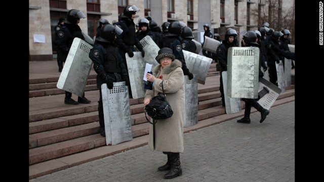 Riot police stand at the entrance of a regional administrative building during a rally in Donetsk on March 5.
