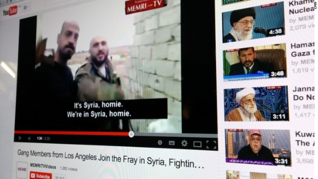 Two men claiming to be Los Angeles-area gang members have posted a video showing them firing rifles in Syria's civil war, apparently fighting on behalf of President Bashar al-Assad's regime.