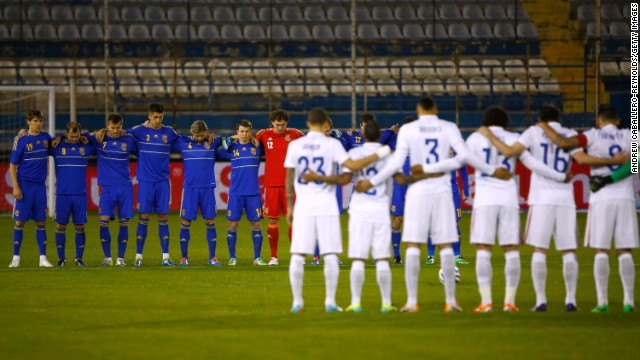 Ukraine and USA players pause for a minute's silence ahead of their friendly game in Larnaca, Cyprus. The contest, which was supposed to take place in Kharkiv, was moved following the outbreak of violence in Ukraine.