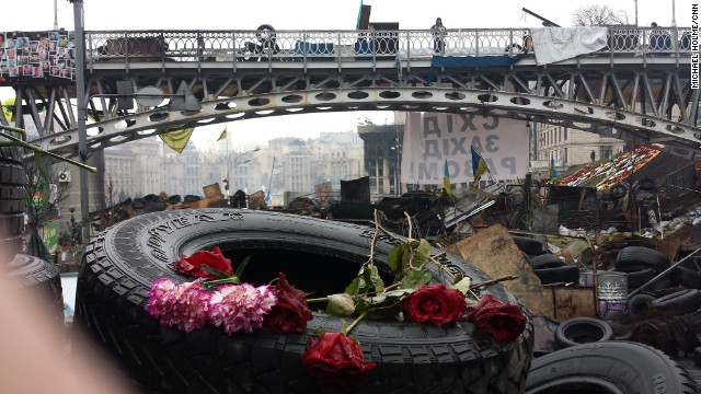 KIEV, UKRAINE: Portraits of people killed during clashes with riot police are left with candles and flowers at Kiev's Independence Square on March 6. Photo by CNN's Michael Holmes. Follow Michael on Instagram at <a href='http://instagram.com/holmescnn' target='_blank'>instagram.com/holmescnn</a>.