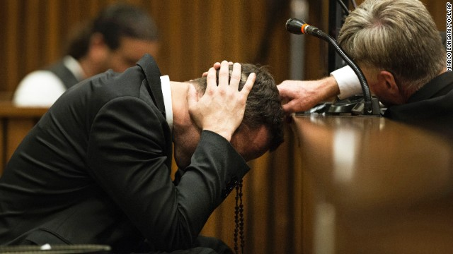 Pistorius covers his ears on Thursday, March 6, as a witness speaks about the morning Steenkamp was shot and killed.