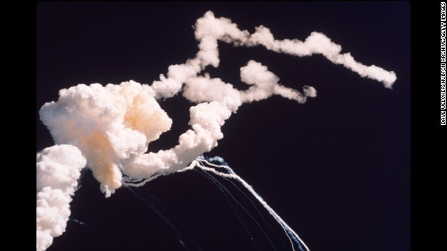 Debris and smoke fills the sky after the space shuttle Challenger explodes above Florida's Kennedy Space Center in January 1986.
