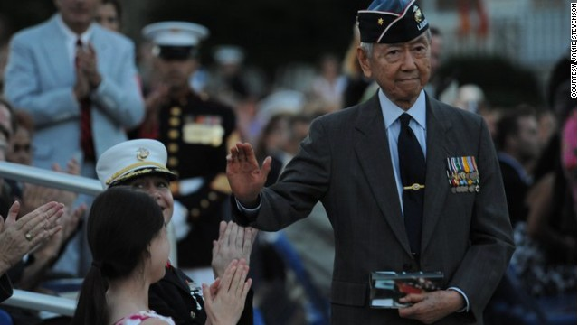 Major Kurt Chew-Een Lee, a decorated three war veteran, is honored in an evening parade in 2010.