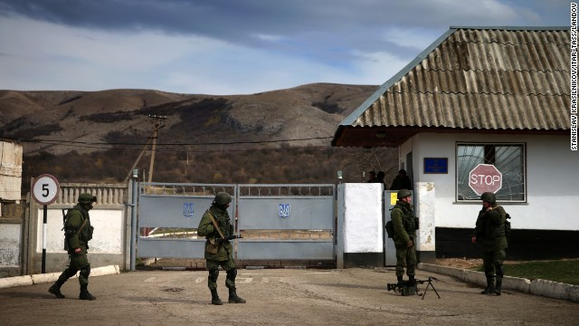 Servicemen guard a checkpoint at a Ukrainian Navy base in Perevalnoe, Crimea, on March 6.