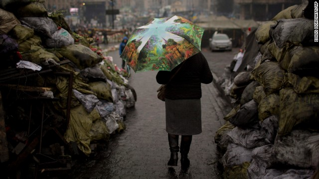 A woman walks past barricades on March 6 that were set up by anti-government protesters in Kiev's Independence Square.