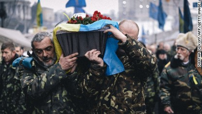 The coffin of a man killed near Maidan Square is carried through central Kiev on Thursday, March 6.