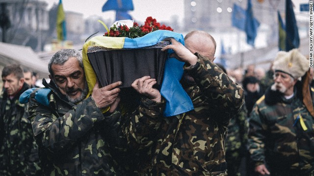 The coffin of a man killed near Maidan Square is carried through central Kiev on Thursday, March 6. Ukrainian officials and Western diplomats accuse Russia of sending thousands of troops into the Crimea region in the past week, a claim Russia has denied. The crisis in the former Soviet republic has revived concerns of a return to Cold War relationships. Follow the evolving story on CNN's live blog.