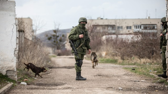 A member of the Russian military patrols around Perevalne, Ukraine, on March 6.