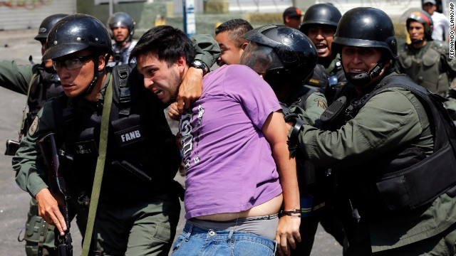 Bolivarian National Guards arrest an anti-government protester during clashes in the Los Ruices neighborhood of Caracas, Venezuela, on Thursday, March 6. For weeks, anti-government protesters in Venezuela -- unhappy with the economy and rising crime -- have been clashing with security forces.