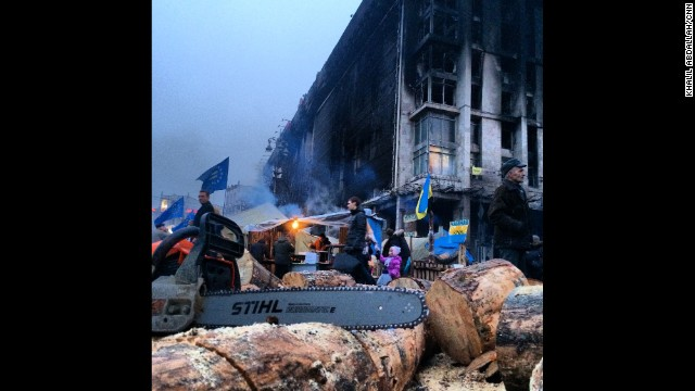 "KIEV, UKRAINE: ""Cutting wood to keep volunteers warm as they continue to guard Independence Square in Kiev."" - CNN's Khalil Abdallah on March 5. Follow Khalil on Instagram at instagram.com/madcameraman."
