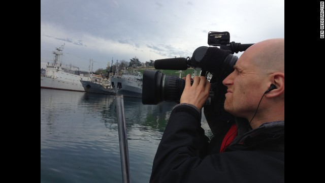 SEVASTOPOL, UKRAINE: Cameraman Chris Jackson captures the Russian Black Sea fleet in Sevastopol on March 5. Photo by CNN's Ben Wedeman. Follow Ben on Instagram at instagram.com/bcwedeman.