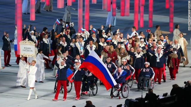 Russian athletes, led by skier and flag bearer Valerii Redkozubov, enter the stadium.