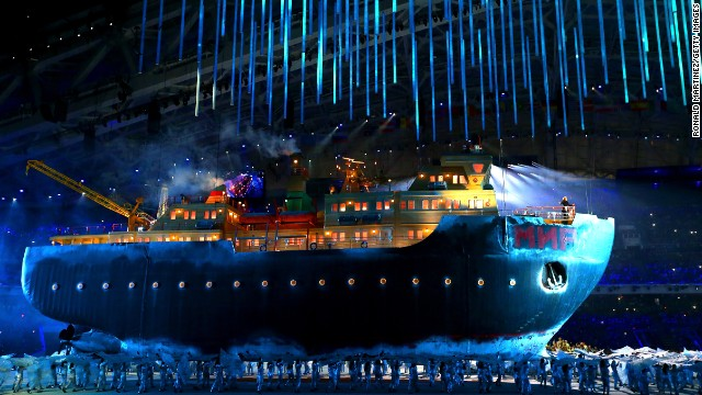 A model of a giant icebreaker enters the arena carrying opera singer Maria Guleghina.