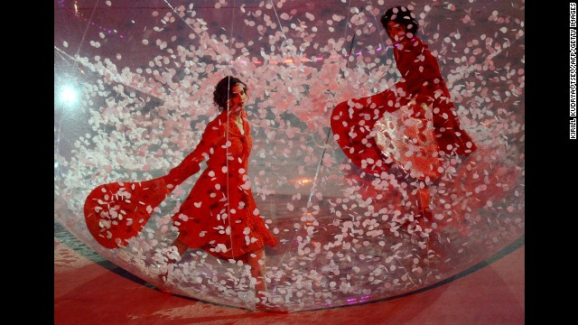 Artists perform in giant spheres.