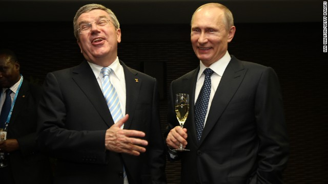 Putin, right, and International Olympic Committee President Thomas Bach laugh during the ceremony.