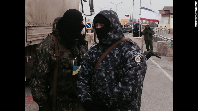 SOUTHERN UKRAINE: Gunmen block monitors from the Organization for Security and Co-operation in Europe (OSCE) who are trying unsuccessfully to negotiate their way into Crimea past pro-Russian border patrols on March 7. Photo by CNN's Christian Streib. Follow Christian on Instagram at <a href='http://instagram.com/christianstreibcnn' target='_blank'>instagram.com/christianstreibcnn</a>
