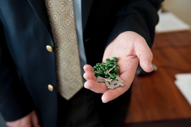 Bob Bowers, a former priest, still keeps rosary beads in his pocket.