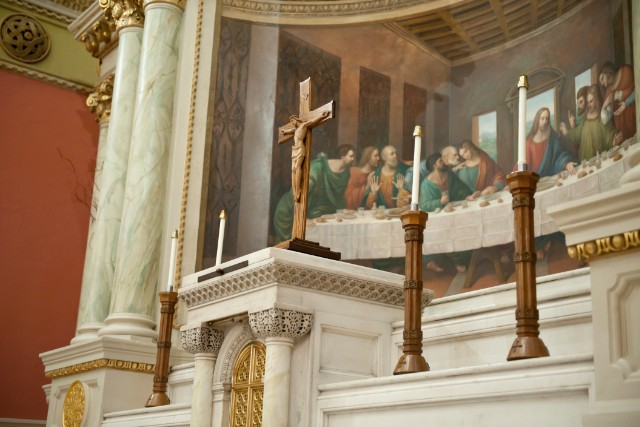 Behind the altar at St. Cecilia Parish is a tableau of the Last Supper.