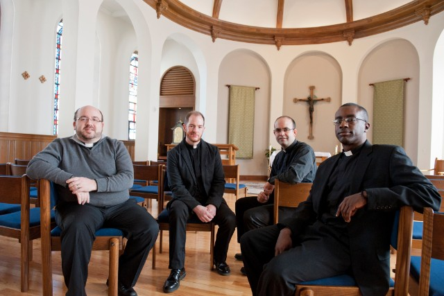 Four young Jesuits: Sam Sawyer, Ryan Duns, Javier Montes and Mario Powell.