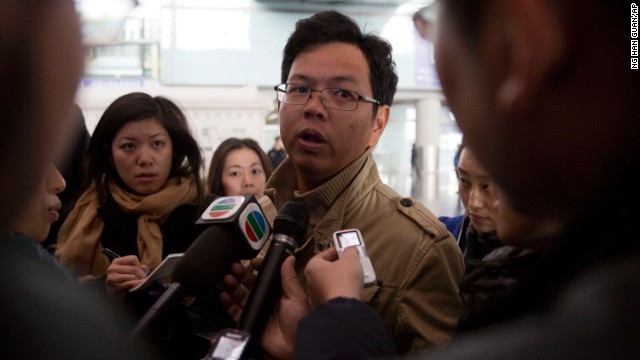 A Malaysian man who says he has relatives on board the missing plane talks to journalists at the Beijing airport on March 8.