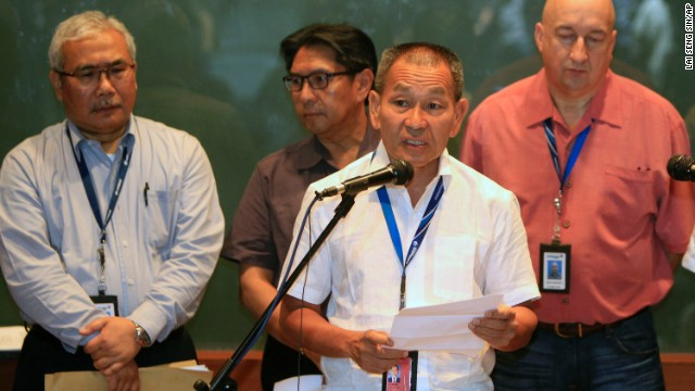 "Malaysia Airlines Group CEO Ahmad Juahari Yahya, front, speaks during a news conference on March 8 at a hotel in Sepang. ""We deeply regret that we have lost all contacts"" with the jet, he said."