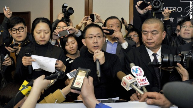 Malaysia Airlines official Joshua Law Kok Hwa, center, speaks to reporters in Beijing on March 8.
