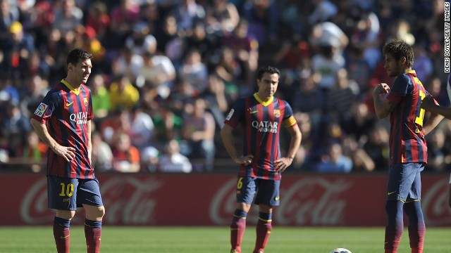 Dejected Barcelona players contemplate defeat at lowly Valladolid in La Liga.