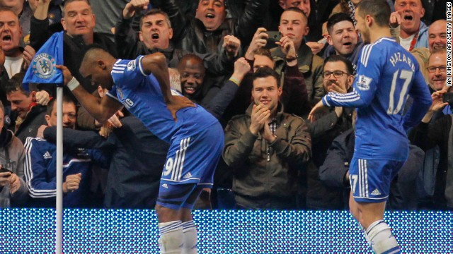 Samuel Eto'o mounts an unusual goal celebration after putting Chelsea ahead against Tottenham.