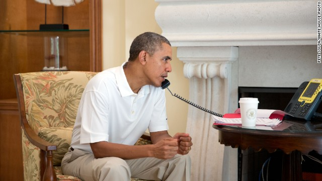 While in Key Largo, Florida, U.S. President Barack Obama talks on the telephone with French President Francois Hollande on March 8 to discuss the situation in Ukraine.