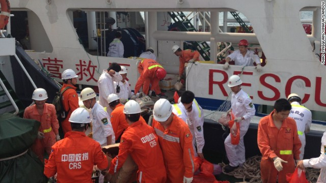 Members of a Chinese emergency response team board a rescue vessel at the port of Sanya in China's Hainan province on March 9. The vessel is carrying 12 divers and will rendezvous with another rescue vessel on its way to the area where contact was lost with Malaysia Airlines Flight 370.