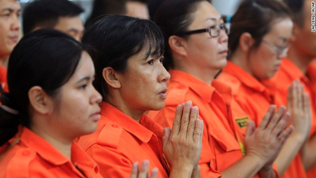 Members of Fo Guang Shan rescue team offer a special prayer on Sunday, March 9, at Kuala Lumpur International Airport in Sepang, Malaysia, for passengers aboard a missing Malaysia Airlines flight. Contact with the Boeing 777-200 was lost as it flew over the South China Sea early Saturday after leaving Kuala Lumpur for Beijing, carrying 227 passengers and 12 crew.