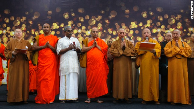 Buddhist monks offer a special prayer for passengers aboard the missing plane at Kuala Lumpur International Airport on March 9.