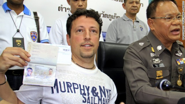 Italian tourist Luigi Maraldi, who had reported his passport stolen in August 2013, shows his current passport during a press conference at a police station in Phuket island, Thailand, on March 9. Two passengers on the missing Malaysia Airlines flight were reported traveling on stolen passports belonging to Maraldi and an Austrian citizen who reportedly had his papers stolen two years ago.