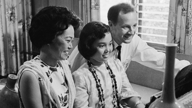 U.S. Rep. Patsy Mink, here with her husband John, and daughter, <a href='http://inamerica.blogs.cnn.com/2012/06/23/how-a-mother-changed-the-world-for-her-daughter/ '>served 24 years in Congress</a>. The Hawaii Democrat co-authored <a href='http://www.cnn.com/2013/07/17/living/gallery/title-ix-women-pioneers/index.html'>Title IX, the women's educational equity act</a>.