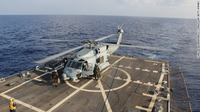 A U.S. Navy Seahawk helicopter lands aboard the USS Pinckney to change crews before returning to search for the missing plane Sunday, March 9, in the Gulf of Thailand.