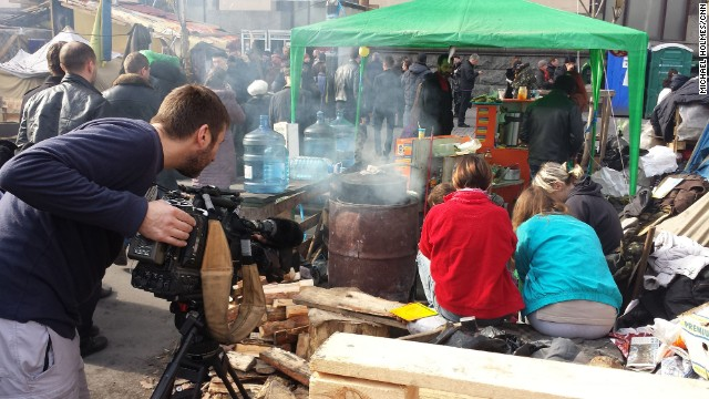 KIEV, UKRAINE: CNN cameraman Scott McWhinnie films volunteers peeling vegetables, preparing meals for protesters still living in tents in Maidan, also known as Independence Square, on March 9. Photo by CNN's Michael Holmes. Follow Michael on Instagram at <a href='http://instagram.com/holmescnn' target='_blank'>instagram.com/holmescnn</a>.