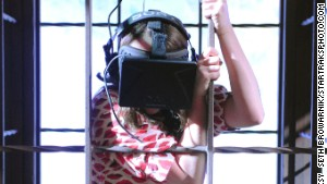 Maisie Williams wears an Oculus Rift headset during a \