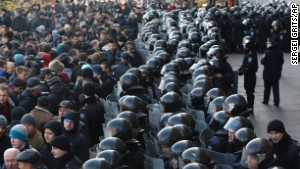 Ukrainian riot police block the entrance of the regional administrative building during a pro Russian rally in Donetsk, Ukraine, Sunday, March 9.
