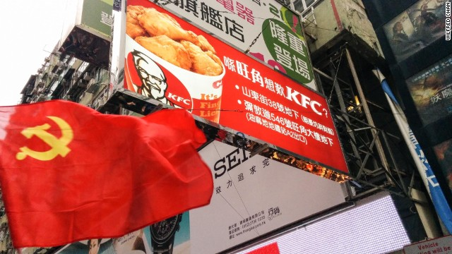 An unlikely sight: A Communist flag billowing in Hong Kong's crowded Mong Kok shopping district.