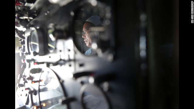 Vietnam air force Col. Le Huu Hanh is reflected on the navigation control panel of a plane that is part of the search operation over the South China Sea on March 10.