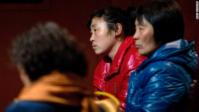 Relatives of the missing flight's passengers wait in a Beijing hotel room on March 10.