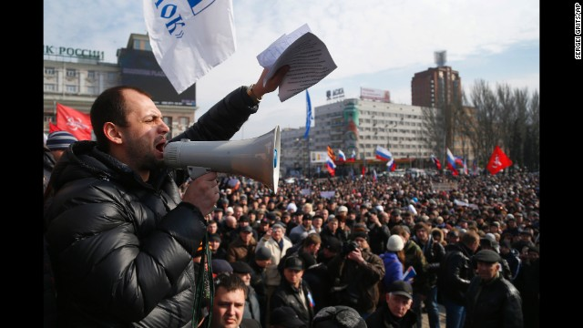 People shout slogans during a pro-Russia rally in Donetsk, Ukraine, on Sunday, March 9. Pro-Russian forces have taken control of Ukraine's autonomous Crimean region, prompting criticism from Western nations and the Ukrainian interim government. The standoff has revived concerns of a return to Cold War relations.