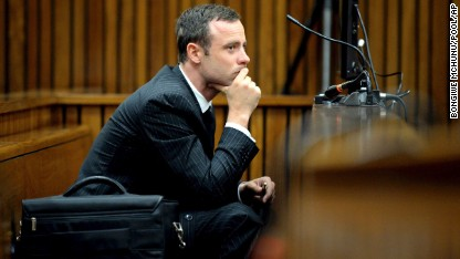 Oscar Pistorius sits in the dock as he listens to cross questioning during his trial in Pretoria, South Africa, on Monday, March 10.