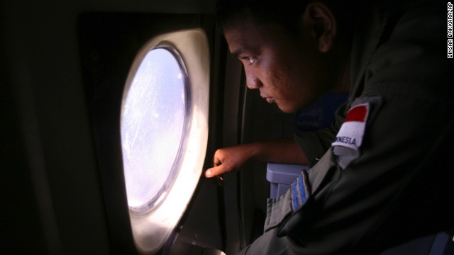 An Indonesian navy crew member scans an area of the South China Sea bordering Indonesia, Malaysia and Thailand on Monday, March 10.