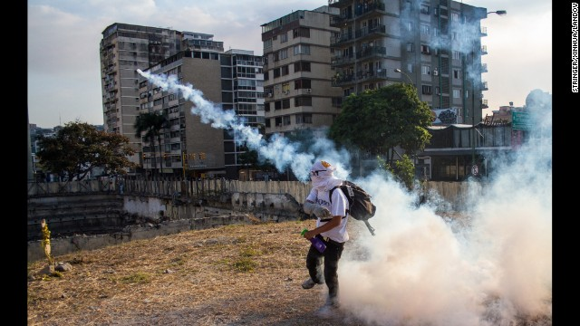 A protester throws a tear gas canister in Altamira, Venezuela, on Sunday, March 9.