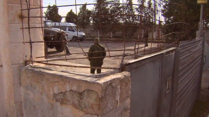 Masked troops on Ukrainian base