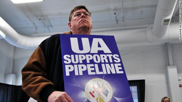 Union members clashed with Keystone opponents at a pipeline hearing in April 2013, in Grand Island, Nebraska.