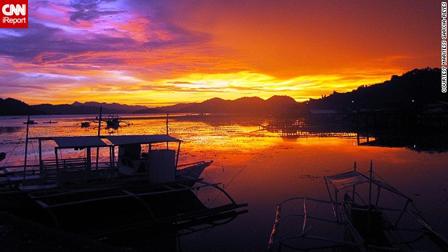 "A sunset illuminates the sky with radiant colors in Coron, Palawan. ""In the Philippines, you need not splurge to see its beauty,"" Maritess Garcia-Reyes said."
